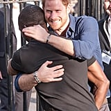 Harry hugged Russell Youth Centre Manager Trevor Rose while visiting the Community Recording Studio in 2016.