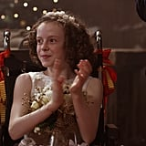 "Now that I've finished three glasses of wine and I'm getting really sick of Amber and Richard's bummer of a plot, I think it's time to discuss how perfect Princess Emily, played by Honour Kneafsey, is. Since Amber isn't dragging her out into the woods to toboggan anymore, Emily is busy starring in Aldovia's Christmas play about an old folktale. The story follows an ogre who falls in love with a princess who has magical powers, who then . . . does some other stuff and somehow gives Santa his magic in the end? Honestly, I don't know. It's bizarre. Amber makes Emily her costume for the play, complete with metallic blue sneakers and Emily totally acts like she's excited about Amber's weird obsession with Converse. What a gem. Sneakers aside, the stage Emily is performing this play on is THE TINIEST STAGE IN THE WORLD. Like, if you lined up all the pairs of maroon Converse Amber owns in a row (I'm assuming about 20 pairs, give or take?) it would be bigger than this sad stage. But who cares, because Emily is crushing on her costar, a quiet cutie named Tom Quill! I would 100 percent watch a spinoff about Princess Emily falling in love. Sadly the workers helping out with the play go on strike because of Richard's initiative, cutting the lights and refusing to work. Emily is heartbroken, and so am I. *pauses to refill wine glass and shed a tear for poor Emily. Emily gets all the best lines in the movie, but my favourite might be when she tells Amber that they can't distract her from the cancellation of the play with a snowball fight by saying ""I have every right to feel sorry for myself."" Carve that on my tombstone."