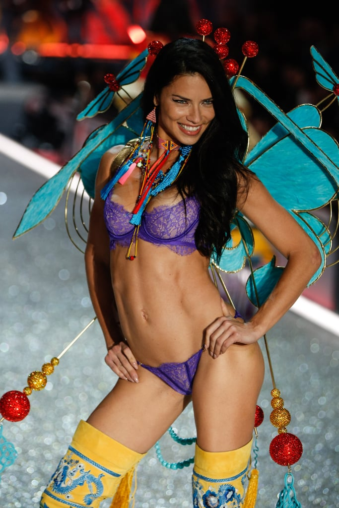 Adriana Lima cemented her place in history last year when she became the longest-running Angel in Victoria's Secret history, and on Wednesday, the Brazilian-born stunner continued her reign when she walked in the brand's annual fashion show for the 17th time. Adriana showed the newcomers how it's done as she strutted her stuff at Le Grand Palais in Paris, showing off her incredible body in a handful of sexy looks while dancing to performances from Lady Gaga, The Weeknd, and Bruno Mars. Keep reading to see the best photos from Adriana's big night, from backstage to the glitzy afterparty!