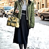 Worn with a ladylike midi skirt, even practical snow boots take on a chic edge.