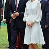 Kate kept an eye on her husband while in Malaysia.