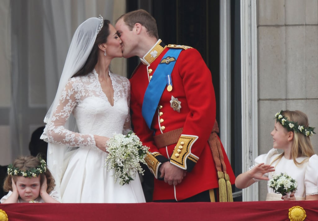 Prince William and his new princess wife, Kate Middleton, shared their first kiss on the balcony of Buckingham Palace in London today and then surprised the crowd with a second smooch! Their sweet lip locks were witnessed by the excited fans below and the duo waved and smiled to their millions of admirers. Prince William and his princess were joined by Queen Elizabeth II, Prince Charles, and Camilla Parker Bowles, Carole and Michael Middleton, Pippa Middleton, Prince Harry, and their young bridesmaids for the public appearance —the face made by three-year-old Grace van Cutsem was priceless! The royal couple were married this morning in a beautiful wedding service at Westminster Abbey, which was followed by a carriage processional. The newlyweds will next attend a brunch reception hosted by the queen and then party into the night with their close friends at a private event given by Prince Charles.