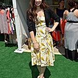 Hailee Steinfeld was a retro vision in a floral fit-and-flare dress and matching T-strap espadrilles, both by Tory Burch.