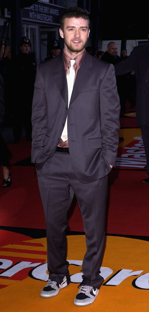 Justin paired his slouchy suit and tie with Nike sneakers at the Brit Awards back in 2004.