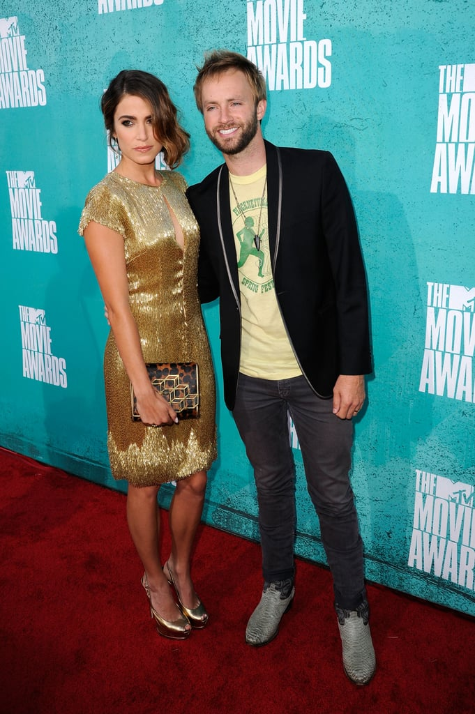 Nikki Reed and her husband, Paul McDonald, dressed up for this evening's MTV Movie Awards in LA. She was decked out in a gold Randi Rahm frock. The event is a special one for them, since it was at last year's ceremony that Nikki and Paul went public with their engagement! They ended up tying the knot in October 2011. Nikki's at the show repping her Twilight franchise, which is up for numerous awards. Breaking Dawn — Part 1, the second-to-last movie in the series, is even in contention for best movie of the year. We'll have updates for you all night about winners and more — make sure to also weigh in on the evening's fashions with our MTV Movie Awards style polls!