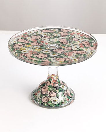 This floral glass pedestal by John Derian Company is actually decoupaged with that design. Source