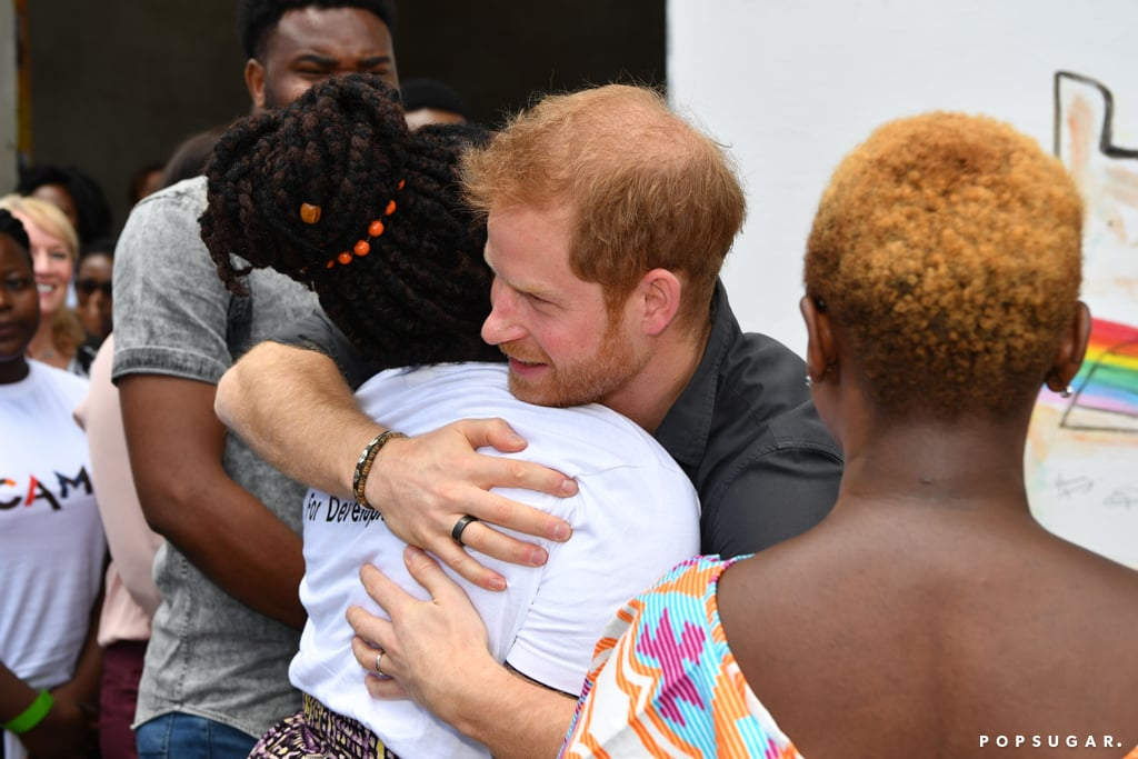 "Prince Harry officially kicked off his solo trip to Zambia on Monday! Upon his arrival, the Duke of Sussex received a warm welcome when a 9-year-old girl named Jane Chawanangwa greeted the royal with flowers at the airport in Lusaka. Shortly after, Harry met with President Edgar Chagwa Lungu at State House and delivered a speech during a special reception to mark the start of his philanthropic visit. ""The goal is to create a platform not only where young people's voices are heard, but where they're supported in achieving their goals,"" Harry said. ""I'm excited to see some of that work in action."" The following day, Harry met with the winners of the Queen's Young Leaders Awards and with Zambian veterans at the Burma Baracks. He also visited BongoHive (Zambia's first technology and innovation hub) and Circus Zambia (an organization that equips young people with life and academic skills) on behalf of the Queen's Commonwealth Trust, of which he is president.  Still, the sweetest moment from Harry's trip, perhaps, was when he broke royal protocol by hugging a young girl who is a member of CAMFED, an organization that aims to eradicate poverty in Africa through educating girls and empowering young women. Royal protocol states that greetings shouldn't go beyond a handshake, but Harry was clearly moved and let his emotions take over.  Nov. 27 also happens to mark the anniversary of Harry and Meghan Markle's engagement announcement. Even though Harry and Meghan didn't get to spend the day together, something tells us Meghan was probably busy getting things ready for their upcoming move to Windsor Estate's Frogmore Cottage. Not to mention, they still have the arrival of their baby and their first wedding anniversary to look forward to.       Related:                                                                                                           14 Gift Ideas For Anyone Who Is Royally Obsessed With Prince Harry"