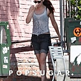 Kristen Stewart wore a backwards baseball hat.