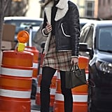 Note to self: invest in a cozy shearling-lined coat like Karlie Kloss's.