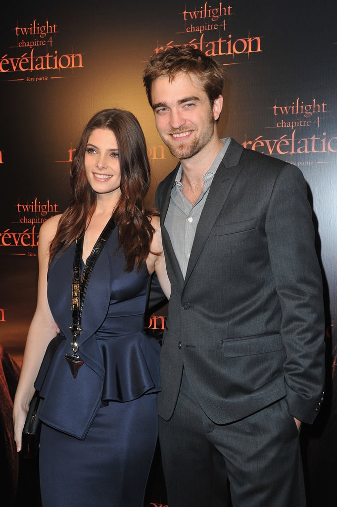 Robert Pattinson and Ashley Greene posed together at the Paris premiere of Breaking Dawn today. The costars were casual when they touched down in France yesterday, though they dressed up for this afternoon's appearance. Ashley wore  a navy Givenchy dress while Rob, who trimmed his facial hair for the event, suited up in Dolce & Gabbana. The red-carpet stop is just the beginning of promotions for the next installment in the Twilight franchise, and Kristen Stewart and Taylor Lautner are expected to join in on press soon. Rob, Kristen, and Taylor will have a hand and footprint ceremony at Grauman's Chinese Theater next month, ahead of the movie's release on Nov. 18.