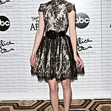 Krysten Ritter's flirty red pumps are just the thing to finish a lacy fit-and-flair frock.