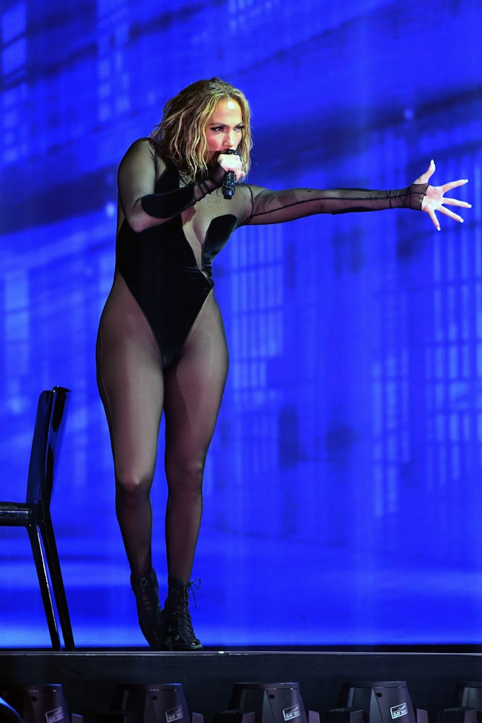 "To the surprise of no one, Jennifer Lopez brought sexy to the American Music Awards stage on Sunday night. The multi-hyphenate joined forces with Maluma for a steamy performance of their collaborations ""Pa Ti"" and ""Lonely,"" and her look did not disappoint. Styled by Rob Zangardi and Mariel Haenn, J Lo wore a sheer high-cut black bodysuit with a plunging neckline designed by none other than LaQuan Smith. She paired the barely-there look with lace-up heels and tousled wet hair. Her look is a departure from earlier in the night, when the singer stunned in head-to-toe silver on the AMAs red carpet. Wearing a sparkling cropped set with structured shoulders and a plunging neckline from Balmain, she looked like a shining goddess. But we all know J Lo is a fan of a show-stopping performance outfit, and her sexy bodysuit certainly exceeded all expectations. Ahead, get a closer look at her outfit from every angle."