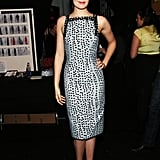 Maggie Grace slipped into a silver-and-black spotted confection with white pumps at Carolina Herrera.