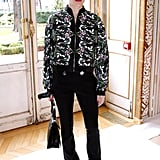Charlotte wore an embroidered bomber jacket and black trousers to the Giambattista Valli show in March 2017.