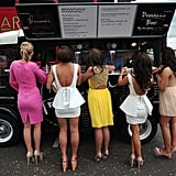 Women were waiting in line for drinks during the Epsom Derby's Ladies Day.