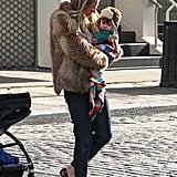 During a chilly day out with her daughter, Marlowe, in NYC, Sienna Miller bundled up in a fur coat, cropped pants, and her leopard loafers.