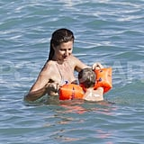 Gisele played with Ben in the water.