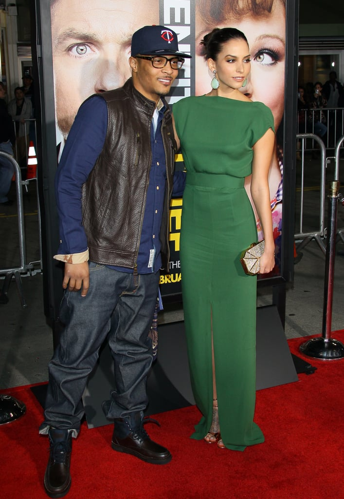 T.I. and Genesis Rodriguez (wearing Raoul) posed for photos on the red carpet in LA.