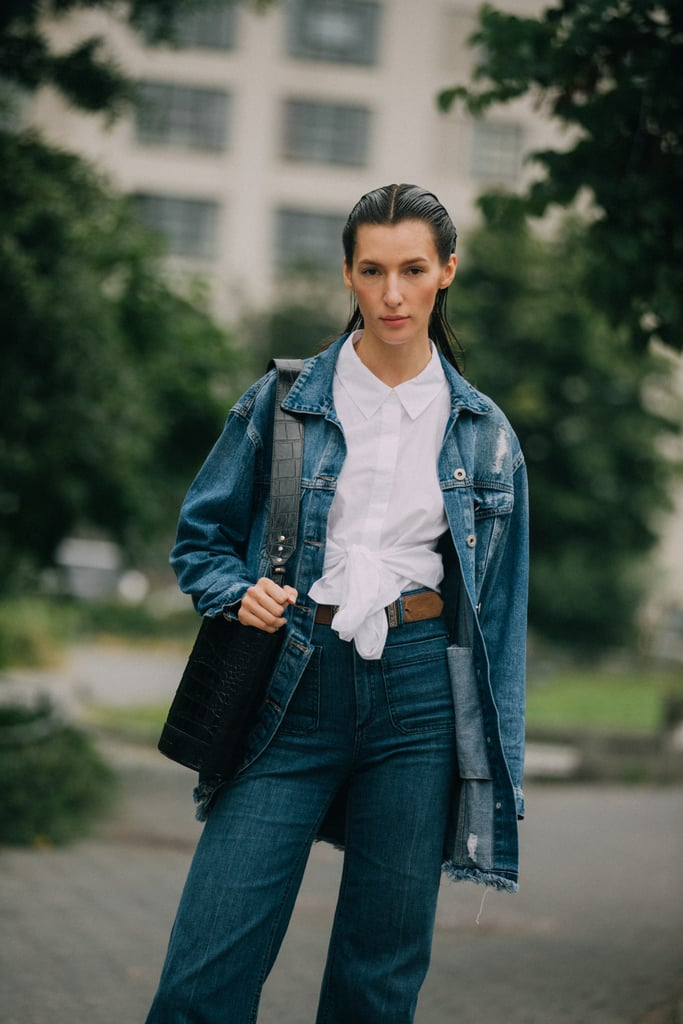Give denim-on-denim a workwear spin with a crisp white button-down and a smart bag.