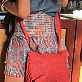 Fringe bags are a hard sell, but this crocodile-embossed coral number gives this bohemian classic an edge.