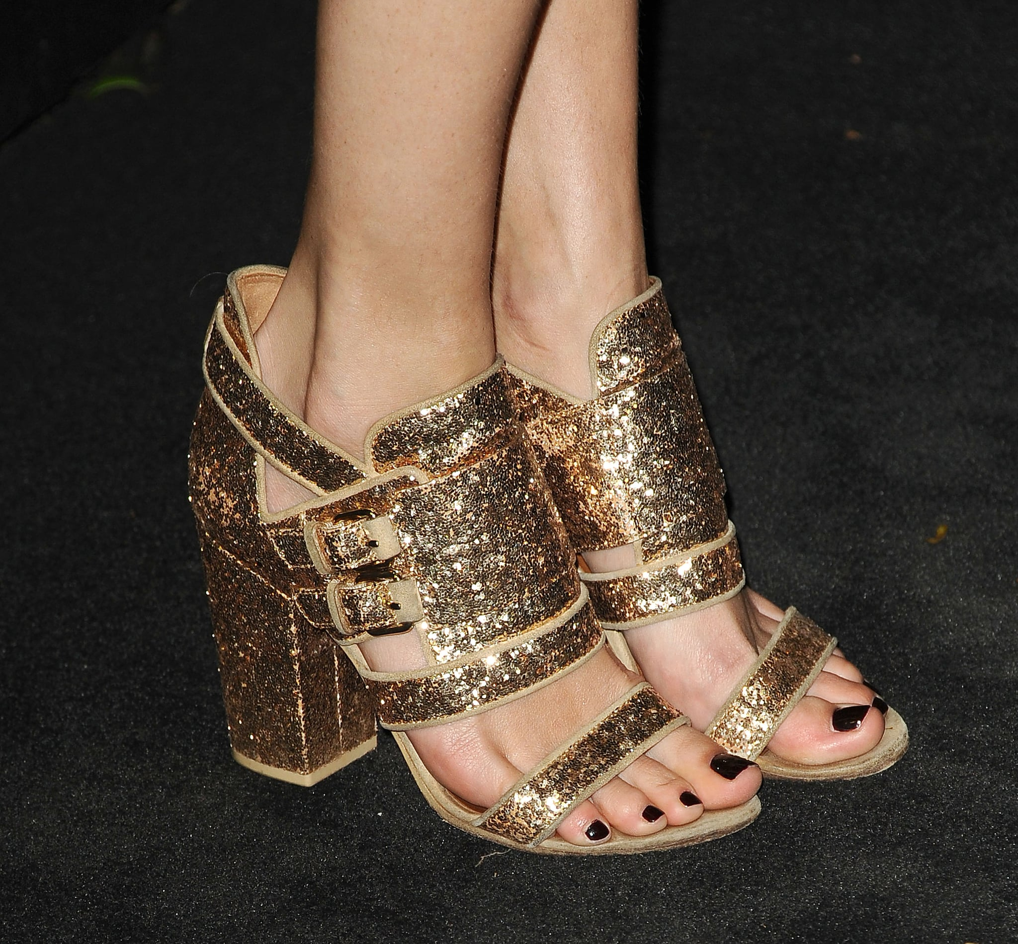 It was all about the glittery gold sandals for Poppy Delevingne's Chanel look.