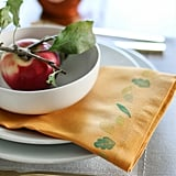 With basic fabric paint and some cute seasonal stamps, you can personalize your tablescape with DIY printed napkins.