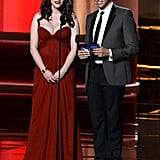 2 Broke Girls star Kat Dennings stood beside Two and a Half Men's Jon Cryer, who won the Emmy for outstanding lead actor in a comedy.