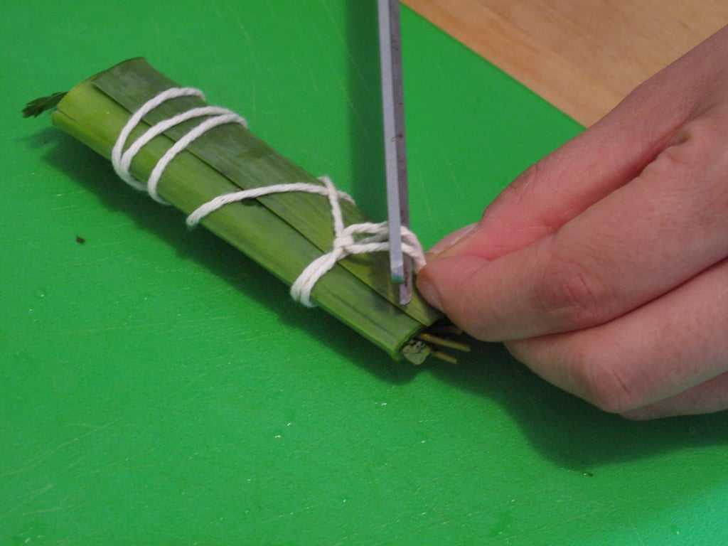 Using scissors, trim the loose ends of the twine hanging off of the knot.