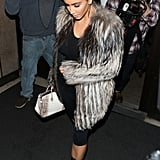 Kim Kept Warm in a Big Furry Coat
