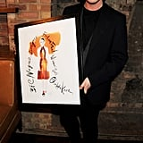 Christopher Kane shows off his David Downton illustration.