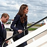 En route from London to North America, William and Kate were all business in matching suits.