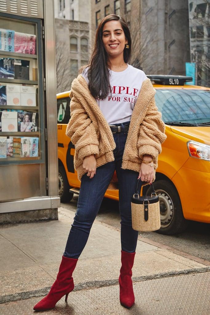On Assistant Editor Nikita Ramsinghani: I.Am.Gia. coat, Ksenia Schnaider t-shirt, Good American jeans, Stuart Weitzman boots, and LPA bag.