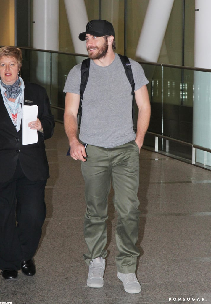 Jake Gyllenhaal gave a smile while walking through the Toronto airport.