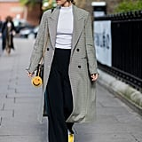 A Checked Coat, White Top, Flared Trousers, and Yellow Trainers