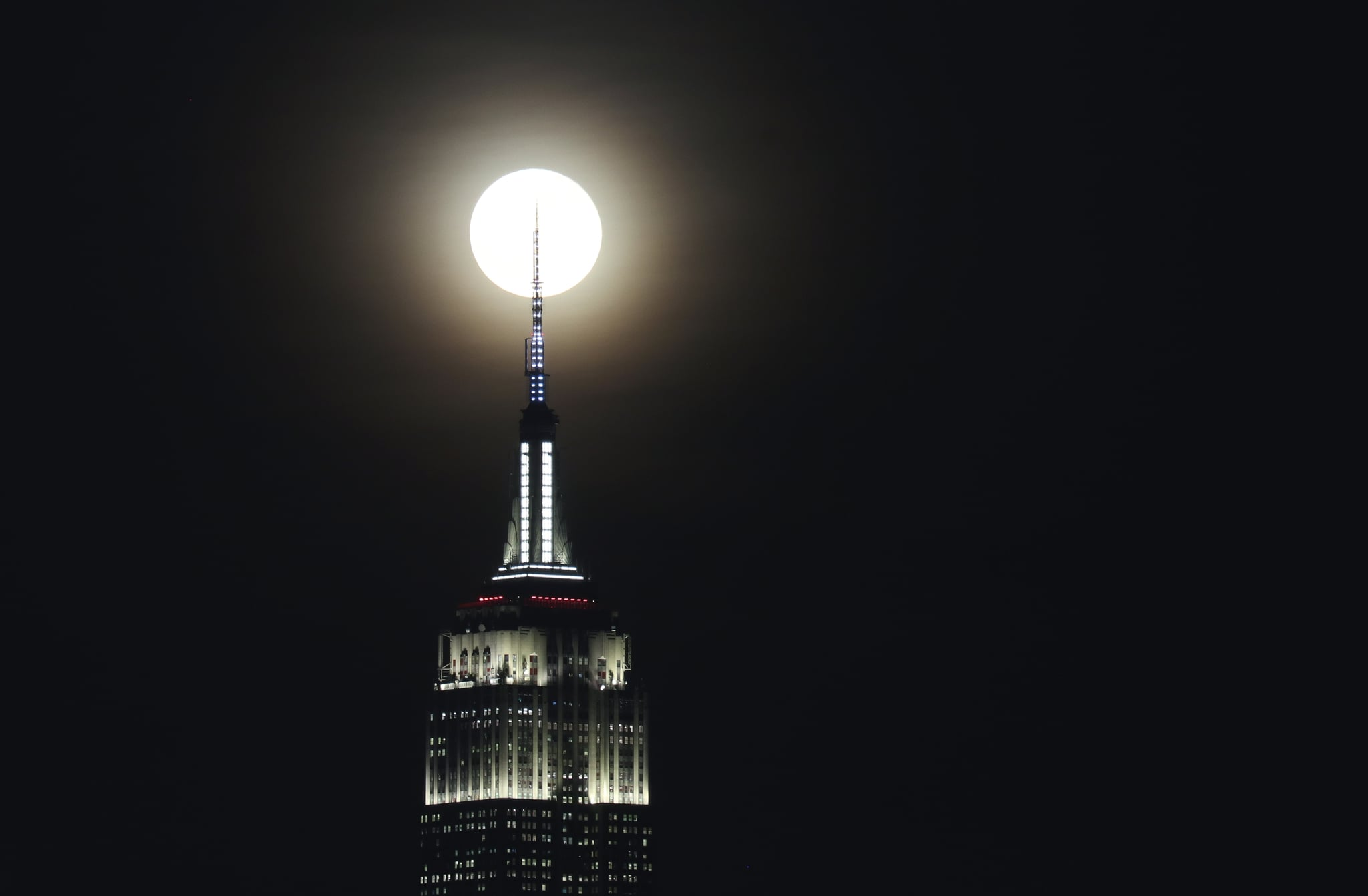 JERSEY CITY, NJ - DECEMBER 12: The full Cold Moon rises behind the Empire State Building in New York City on December 12, 2019 as seen from Jersey City, New Jersey. (Photo by Gary Hershorn/Getty Images)