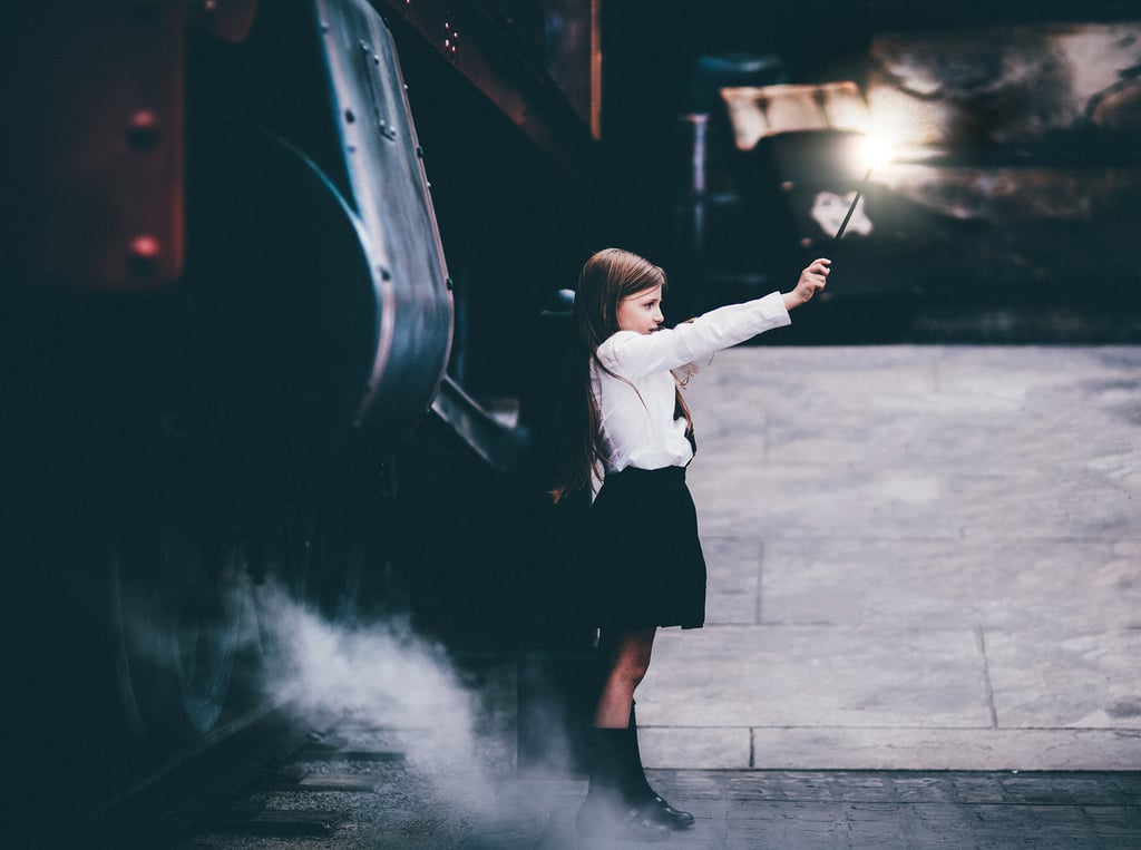 Casting a spell in front of the Hogwarts Express.