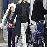 Kate Moss styles up a cool-girl Winter look with a pair of leopard-print skinnies.