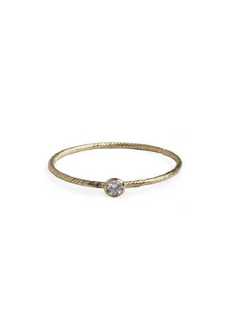 We adore the simple textured band and small diamond.  Wouters & Hendrix Single Diamond Ring ($325)