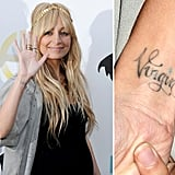 "Nicole Richie has the word ""Virgin"" written in cursive on her right wrist. It's symbolic of her astrological sign, Virgo. She has since expressed regrets about getting it done, saying ""now I just look really weird having 'virgin' written across my wrist – and I have to explain it."""