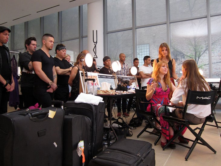 Makeup artist Charlotte Tilbury walks her MAC team through the show's look.