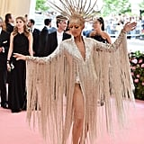 So Camp: Celine Dion In a 22-LB Dress Inspired By the Ziegfeld Follies Costumes From the '30s