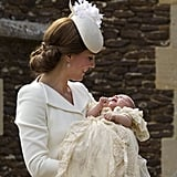 Kate couldn't help but smile widely at Charlotte on the day of her christening.