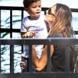 Gisele Bundchen hung out with Benjamin on a park bench.