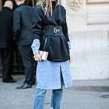 Create a multidimensional look when you throw a statement sweatshirt over a striped dress and boyfriend jeans.