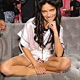 Adriana Lima got comfortable while she waited for the show to start.