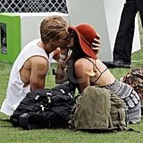 Vanessa Hudgens and Austin Butler kissed in the grass.