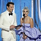 Bradley and Gaga hit the stage together to present an award.