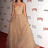Olivia Wilde in a frothy nude Monique Lhuillier.