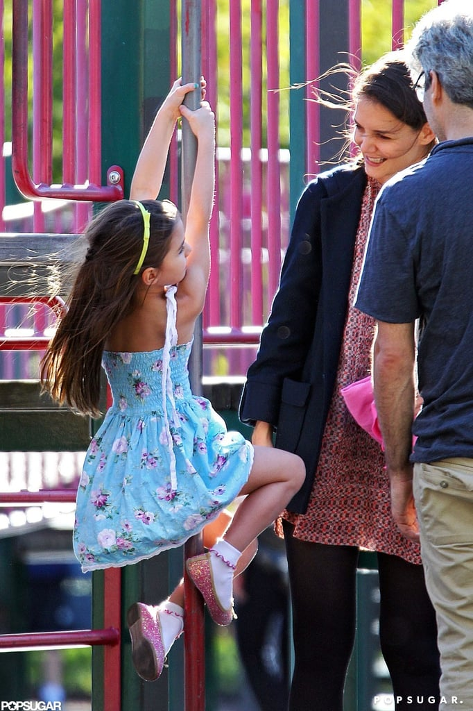 Katie Holmes watched over Suri while she played on the playground.