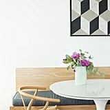 We love the combination of a modern lacquered tulip table and a Scandanavian-style wood chair.